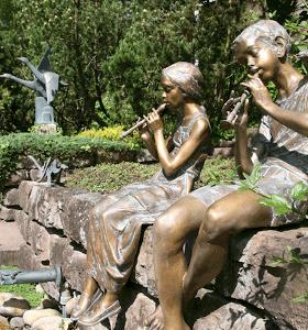 Strassacker sculpture garden with flute players